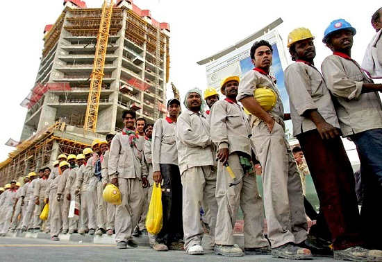 Foreign workers stand in line to take a bus that will transport them to where they live at the end of their shift at a construction site in Dubai on April 16, 2008. Emarati officials warned during a two-day conference on National Identity held in Abu Dhabi of the dangers of social instability created by large foreign minorities. AFP PHOTO/KARIM SAHIB (Photo credit should read KARIM SAHIB/AFP/Getty Images)